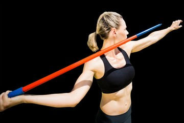 Composite image of sportswoman preparing to javelin throw