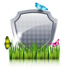 Gray shield with flying butterflies by the grass.