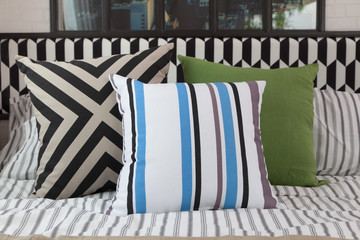 modern bedroom interior with striped pillow on bed