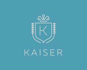 Elegant monogram letter K logotype. Premium crest logo design. Shield, royal crown symbol. Print, t-shirt shape.