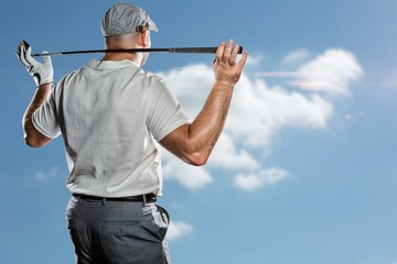 Composite image of rear view of golf player holding a golf club