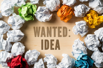 "crumpled paper as symbol for ideas with the sentence ""wanted: ideas"""