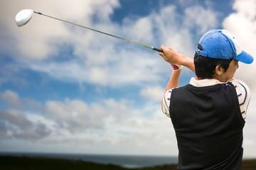Focused man playing golf