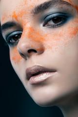 beauty portrait of a beautiful girl with orange eye drops. fashi