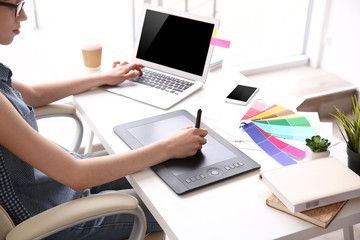 Woman using graphic tablet at office