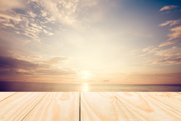 Wood table top on sunrise sky and beach background