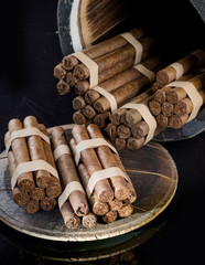 Cigars, aged in a barrel, impregnated aroma of oak and brandy