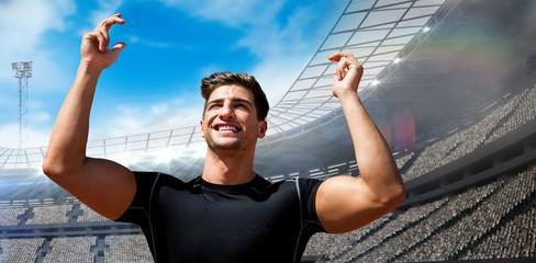 Composite image of portrait of happy sportsman