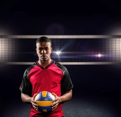 Composite image of sportsman holding a volleyball