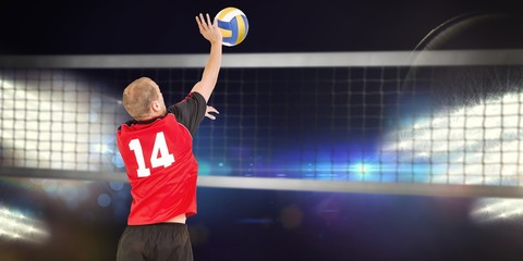 Composite image of rear view of sportsman hitting volleyball