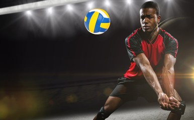 Composite image of sportsman playing volleyball