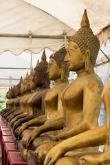 Row of golden Buddha statues at Champa temple,Taling Chan,Bangkok,Thailand