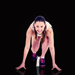 Composite image of athlete woman in ready to run position