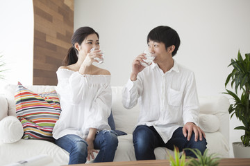 Young couple are drinking delicious water
