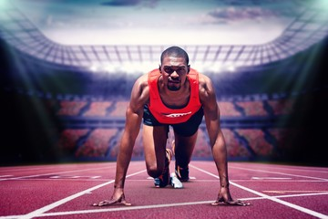 Composite image of athlete man in the starting block