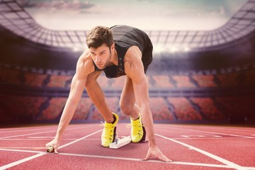 Composite image of sportsman starting to sprint