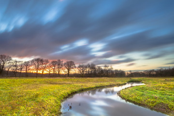Wall Mural - Sunset Creek with Blurred Clouds