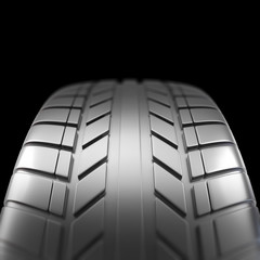 Car tire in close-up view on black background with focus effect. 3d illustration
