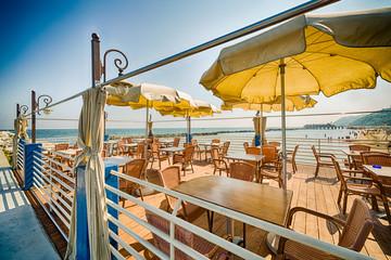 tables and umbrellas on adriatic coast