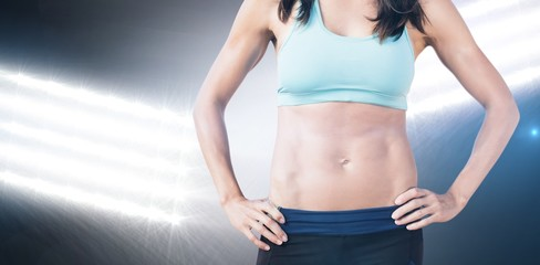 Composite image of portrait of sportswoman chest is posing