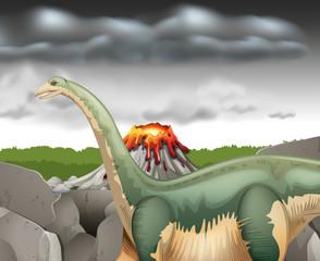 Scene with dinosaur and volcano