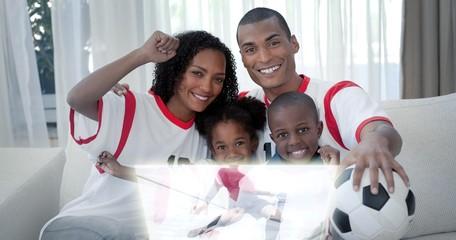 Composite image of family celebrating a football goal