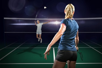 Composite image of badminton players playing badminton