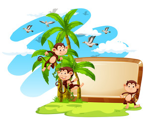 Sign with monkeys and coconut tree