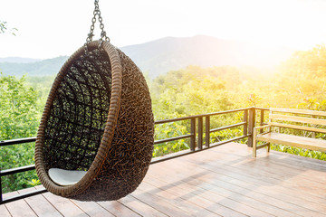 Rattan lounge hanging chair with white  pillow