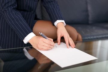 Businesswoman sign blank paper in formal wear