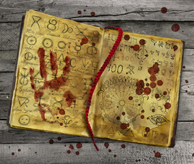 Alchemic book with bloody hand print and drops on the pages