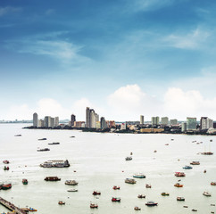 Aerial view cityspace of Pattaya city in Thailand with sea, bay and many ships