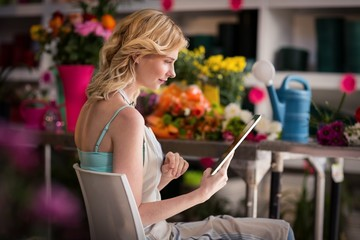 Female florist using digital tablet in florist shop