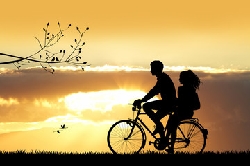 couple on bicycle at sunset