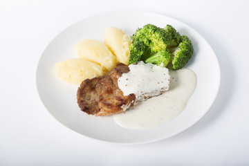Beef steak with potato garnish