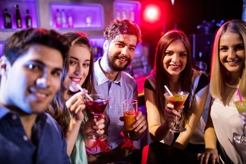 Group of friends having cocktail at bar counter