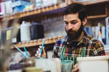 Bearded man working in workshop