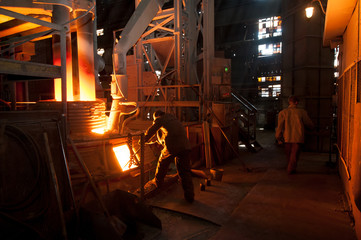 Steelworker near a arc furnace