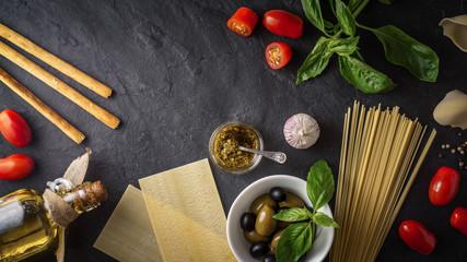 Set of Italian food on the black stone table