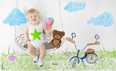 Little baby boy sitting on drawn swing