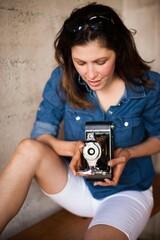 Mid adult woman using vintage medium format camera