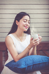 Beautiful asian woman enjoys fresh coffee in the morning. Happy time.