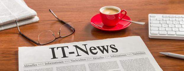 Zeitung auf Schreibtisch - IT-News