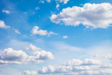 Blue sky with light cumulus clouds.