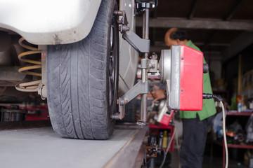 Close up shot of car wheel centering machine adjustment selectiv