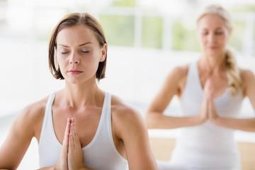 Women doing yoga exercises