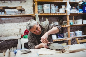 Mature man working at workshop