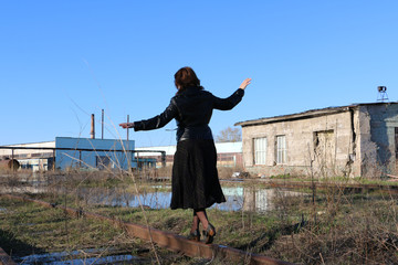 Romantic girl and old railway in water