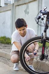 The man pumping bicycle wheel