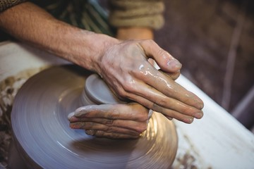 Cropped image of craftsman in potter workshop